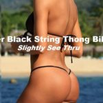 Full view, string thong with t back styling. sheer black fabric