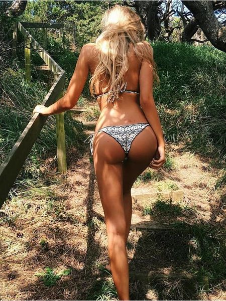 Gabrielle Epstein again, on her way up the stairs in a floral cheeky bikini