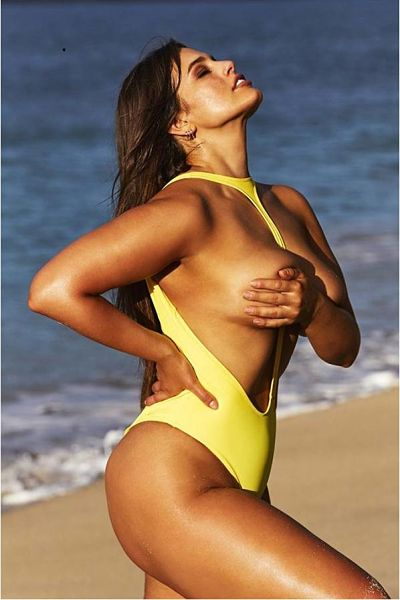 Oh and yes we have a yellow topless one pice thong swimsuit with Ashley Graham showing lots of side boob.