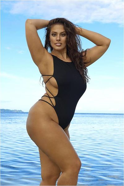 And here we have Ashley Graham wearing a one pice lack thong swimsuit with open laced side panels.