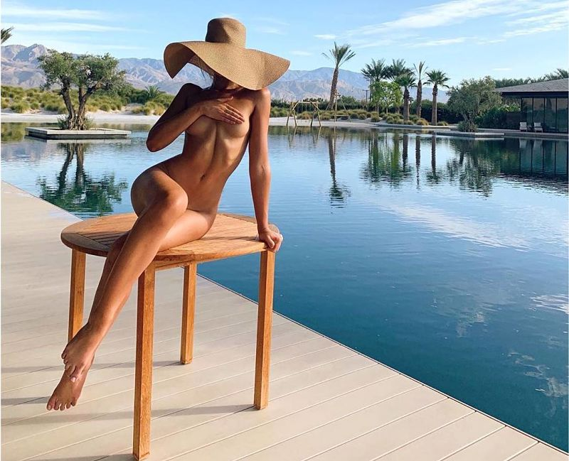 Gabby Epstein nude by the pool displaying her sensuous curves