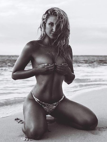 A beautiful black and white pic of Gabrielle Epstein on the beach topless wearing an exotic multi strap thong bikini bottom