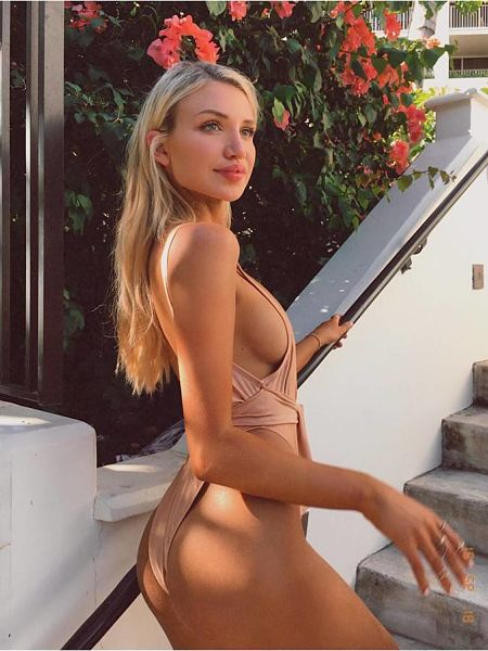 More side boob from Gabby in her nude coloured high cut swimsuit
