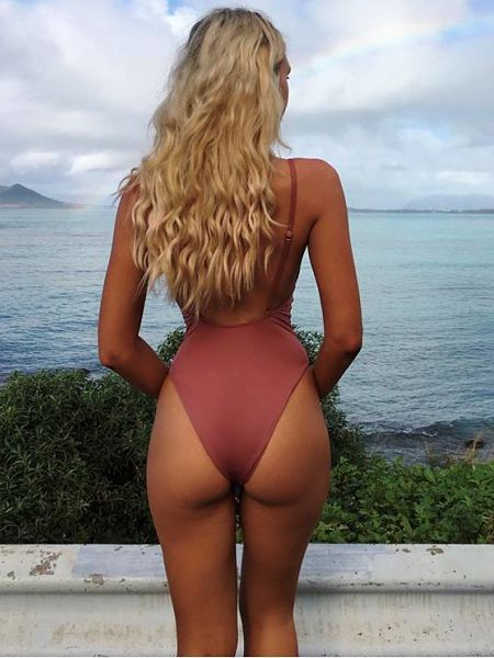 Check this out, Gabrielle Epstein is wearing a rose coloured classic sheer one piece swimsuit with high cut thighs