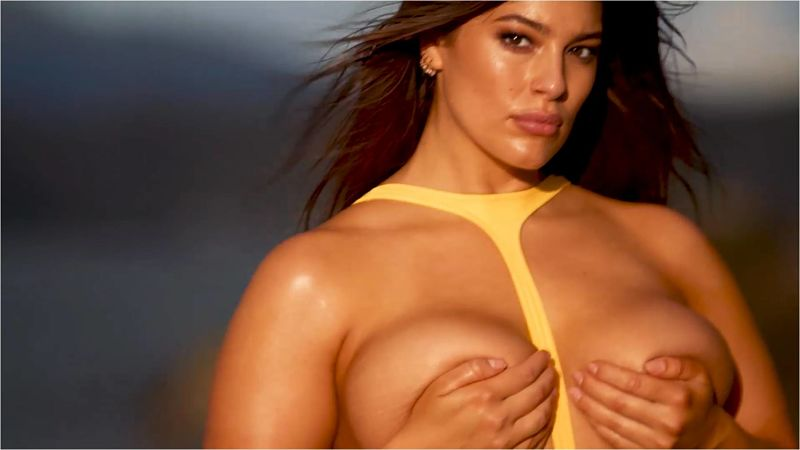 Ashley Graham, plus size swimwear model, topless showing off her ample cleavage.