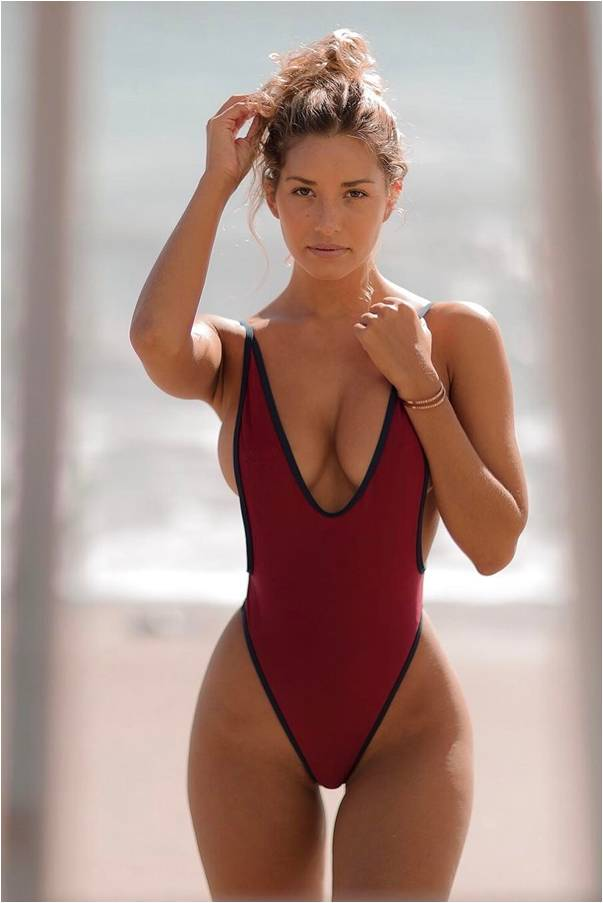 Yup, here it is, Sierra Skye wearing a red sport one pice thong swimsuit with black outlined trim