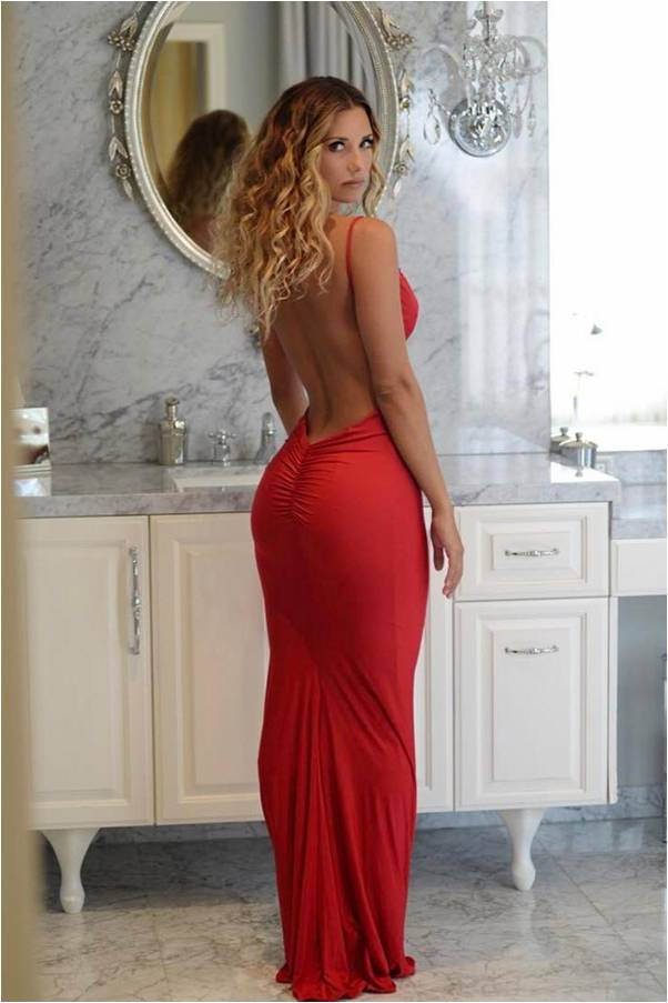 Red backless evening gown showing off Sierra Skye's sexy backside