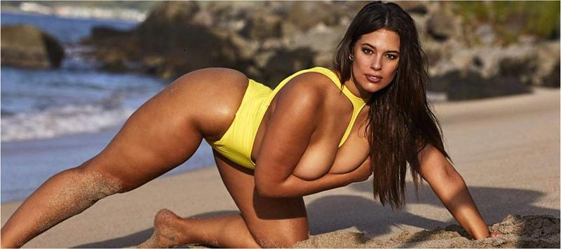Ashley Graham showing off her best assets topless in a one piece thong swimsuit