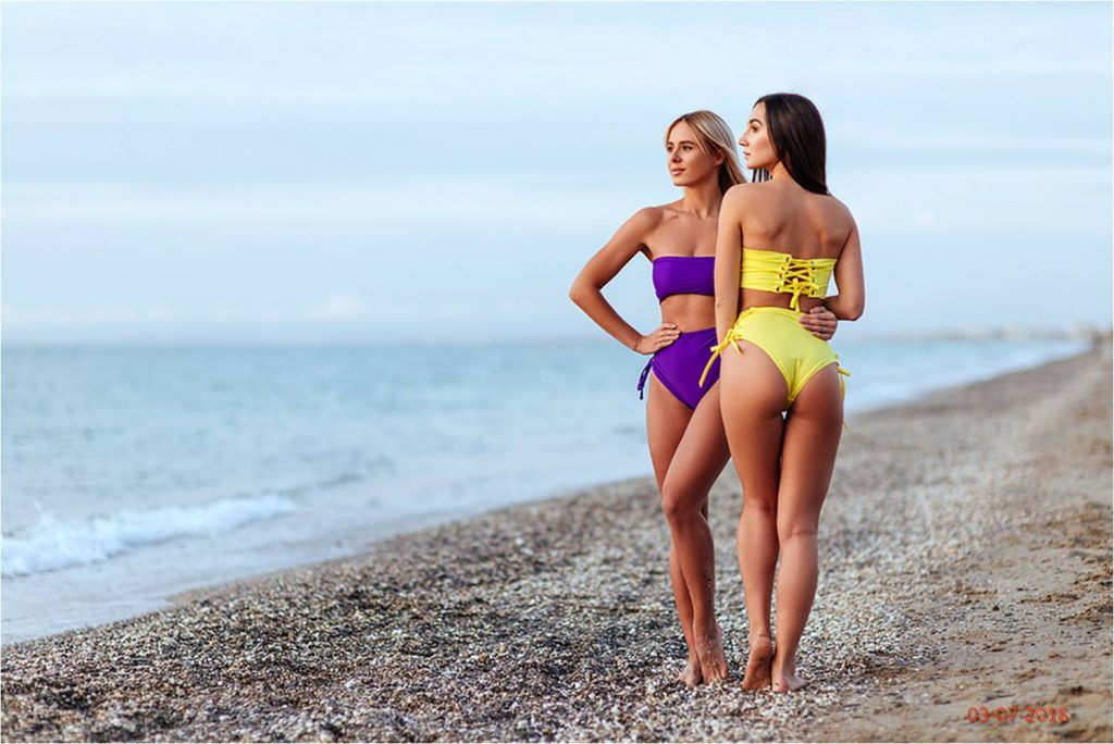 Here we are in yellow and purple thong bikinis respectively