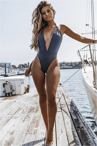 Sofia Jamora in a high cut one piece thong swimsuit with ultra plunging neckline