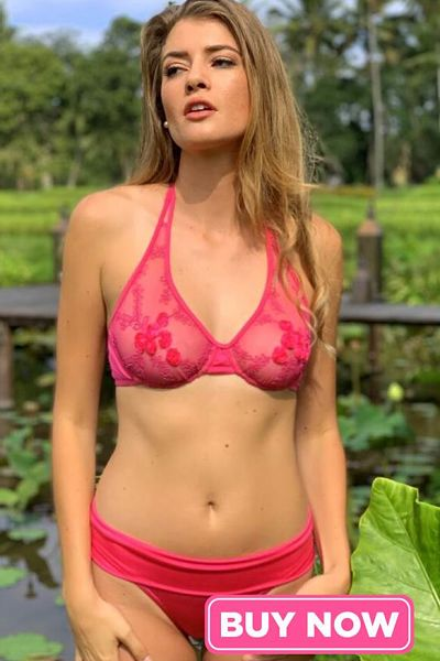 Rose colored lace underwire bikini top, with mesh fabric and strategically placed rosettes